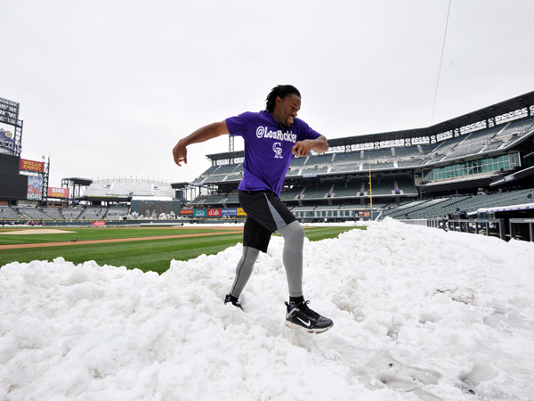 Rockies second basman Eric Young Jr. dodges the snow. (AP)