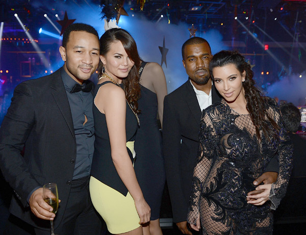 John and Chrissy share a photo with Kanye West and Kim Kardashian on New Years Eve last December :: Denise Truscello/WireImage