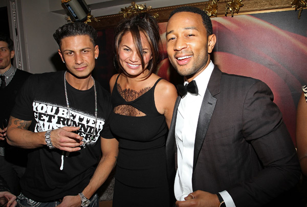 Pauly D poses with the couple during John's birthday party in Jan. 2011 :: Jerritt Clark/Getty Images
