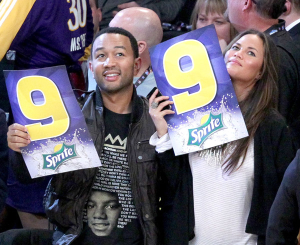 John and Chrissy give a score of 9 during the 2011 Slam Dunk Contest :: Noel Vasquez/Getty Images