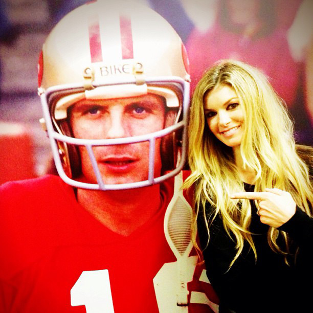 Marisa poses next to a Joe Montana poster :: @marisamiller