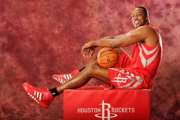 Dwight Howard wears the D Howard 4 during his introductory photo shoot with the Rockets. (Bill Baptist/Getty Images)