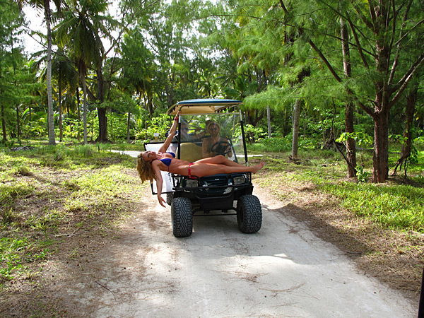 Anne V rides dirty on the hood of a golf cart in Seychelles for the 2012 issue.