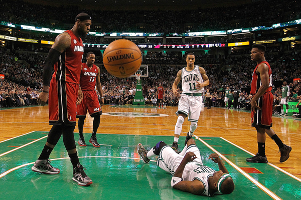 LeBron James (left) leveled Celtics guard Jason Terry with a vicious poster dunk. (J Rogash/Getty Images)