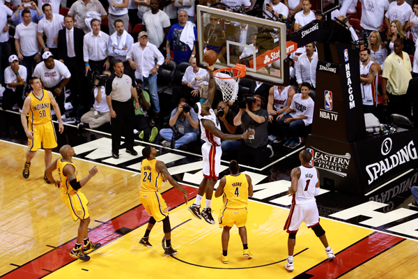 LeBron James (center) made the winning lay-up in overtime to defeat the Pacers in Game 1 of the conference finals. (Chris Trotman/Getty Images)