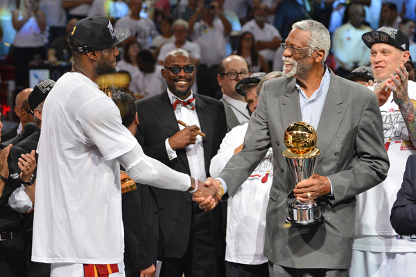 LeBron James (left) received his second straight Finals MVP award from NBA legend Bill Russell. (Jesse D. Garrabrant/Getty Images)