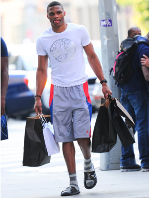 Russell Westbrook, clad head to toe in Jordan Brand, stocks up on more clothes during Fashion Week. (Raymond Hall/Getty Images)