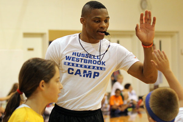 Russell Westbrook encourages youngsters during his eponymous basketball camp. Maybe his best look of the whole offseason. (Michael Bezjian/Getty Images)