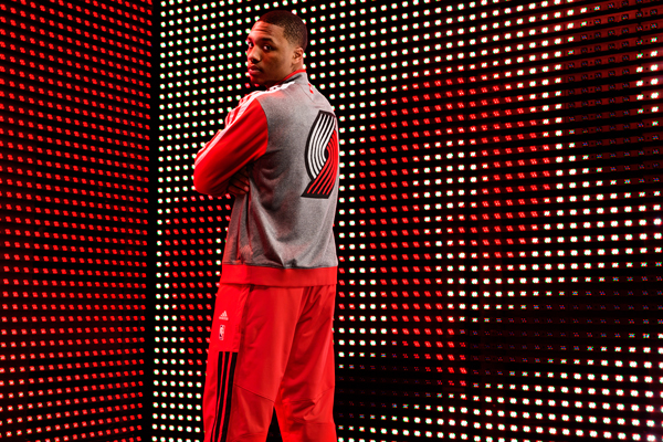 Damian Lillard models the Blazers' new varsity jacket. (Adidas)