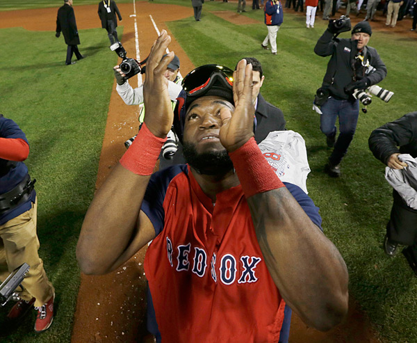 A close-up of David Ortiz celebrating a World Series victory. (AP Photo/David J. Phillip)