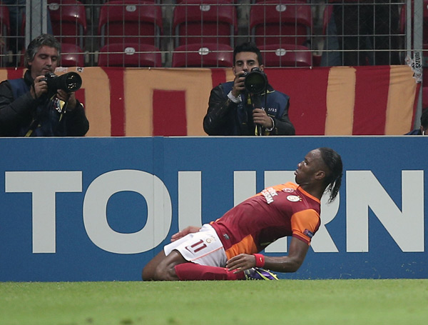 Galatasaray's Didier Drogba celebrates his goal during their Champions League Group B soccer match against FC Copenhagen. (AP)