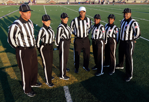 The first ever majority-female officiating crew for an NCAA game poses before Thursday's Miles-Lane contest. (AP)