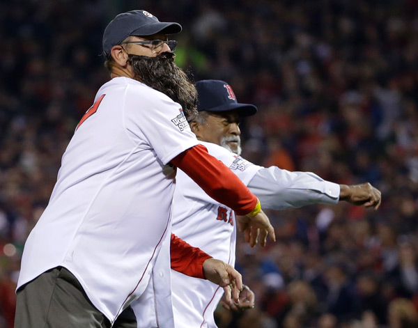 Red Sox legends Carlton Fisk (fake beard) and Luis Tiant (real beard) throw out the first pitch. (AP Photo/Matt Slocum)