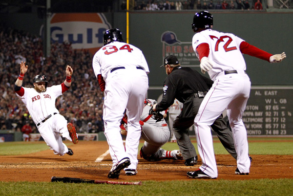 Jonny Gomes slides home during the third inning of Game 6. (Rob Carr/Getty Images)