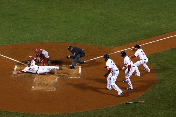 Gomes is called safe on the play, giving the Red Sox a 3-0 lead. (Jamie Squire/Getty Images)