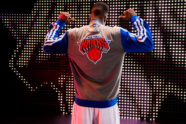 Iman Shumpert models the Knicks' new varsity jacket. (Adidas)