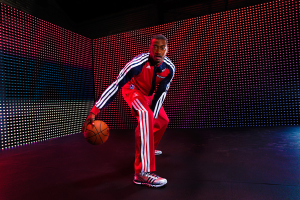 John Wall models the Wizards' new warm-up jacket. (Adidas)