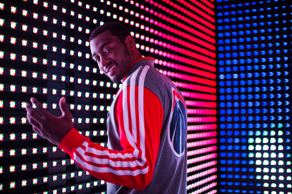 John Wall models the Wizards' new varsity jacket. (Adidas)