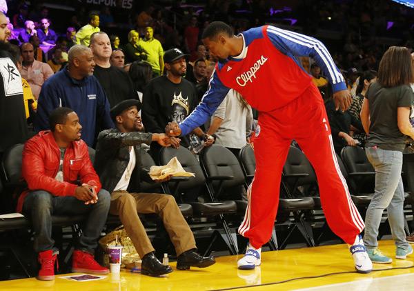 DeAndre Jordan greets  Floyd Mayweather Jr. before last night's season opener against the Lakers. (AP Photo/Danny Moloshok)