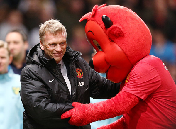 Manchester United manager David Moyes shakes hands with  mascot Fred the Red before Tuesday's match against Norwich City. (Matt West/BPI/Icon SMI)