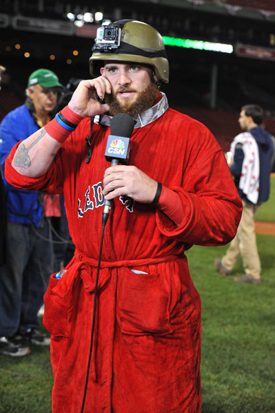 Jonny Gomes shows off his Red Sox robe and helmet-cam after the Red Sox beat the Tigers to advance to the World Series on Saturday. (Michael Tureski/Icon SMI)