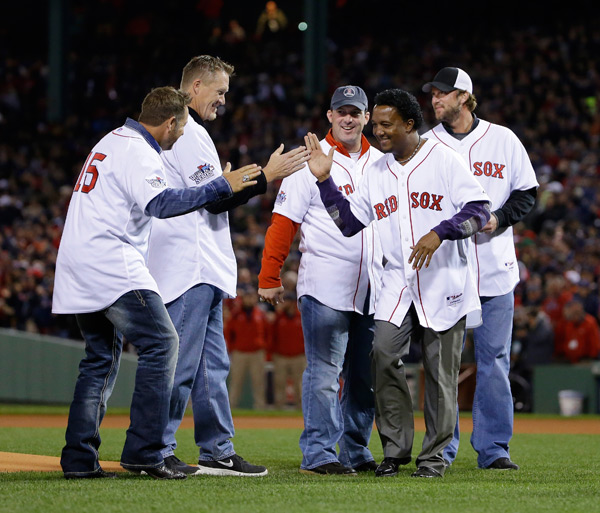 Pedro Martinez, who celebrates his 42nd birthday today, greets former teammates before last night's game. (AP)
