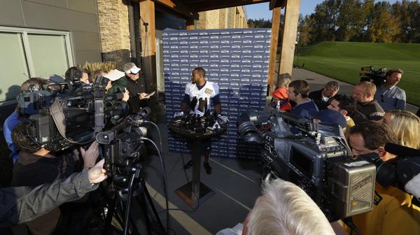 Percy Harvin talks to reporters after his first practice with the Seahawks on Tuesday. (AP Photo/Ted S. Warren)