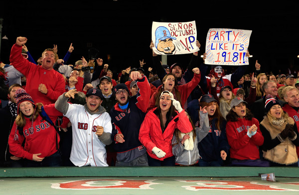 Red Sox fans get ready to celebrate the franchise's first World Series home victory since 1918. (Jamie Squire/Getty Images)