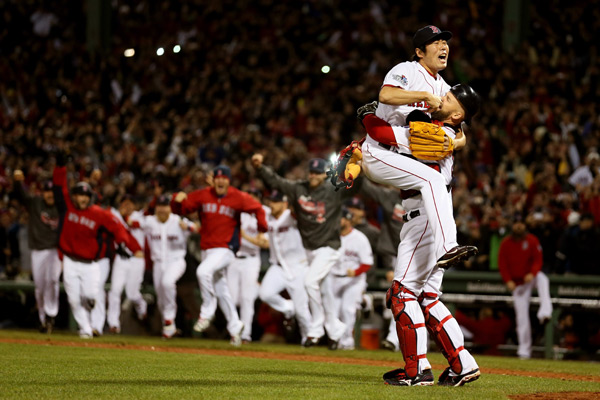 Koji Uehara celebrates a World Series victory with David Ross after the final out. (Rob Carr/Getty Images)