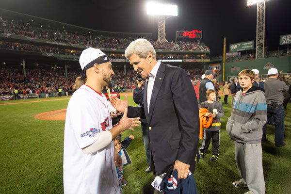 Among the stranger sites from Fenway Park on Thursday: John Kerry and Shane Victorino sharing an awkward high-five. (Rob Tringali/Getty Images)