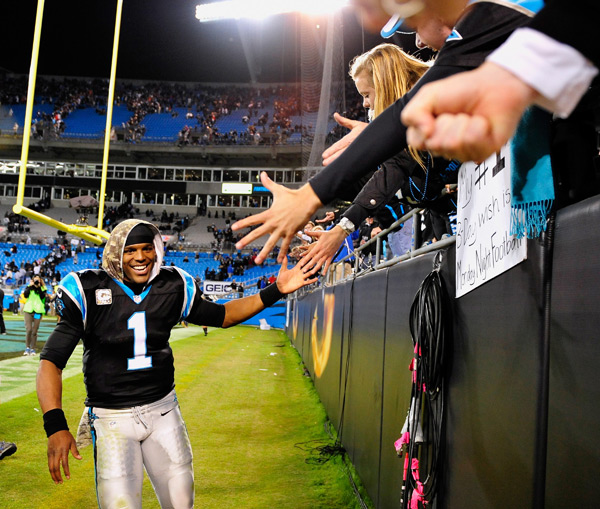 Cam Newton high fives fans after the Panthers victory. (Grant Halverson/Getty Images)