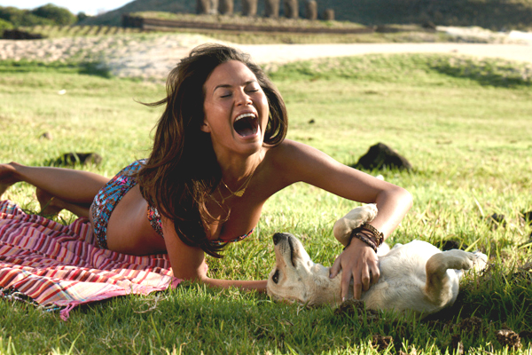 Chrissy Teigen and set-crashing pup  ::  David Burton/SI