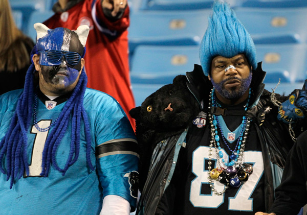 Panthers fans dress up for last night's game. (AP)