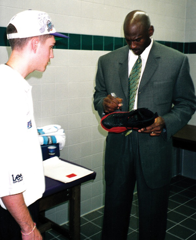 "Michael Jordan autographs his ""Flu Game"" shoes for Jazz ball boy Preston Truman. (GreyFlannelAuctions.com)"