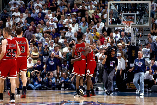 "Scottie Pippen helps carry Michael Jordan off the court during the ""Flu Game."" (Dick Raphael/Getty Images)"