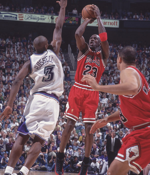 "Michael Jordan elevates over Bryon Russell during the ""Flu Game."" (John W. McDonough/SI)"