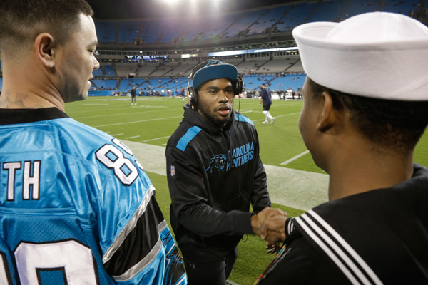 Steve Smith greets a seaman before the game.  (AP)