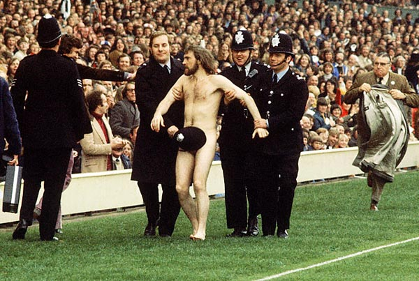 streaker is arrested during a 1974 match between England and Wales.