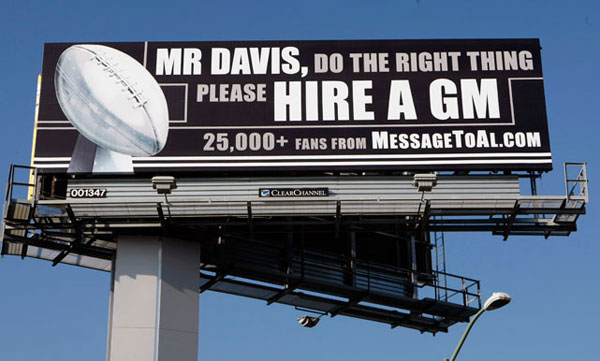 Disgruntled Raiders fans posted their dismay with the late Al Davis's front office management near a highway in Oakland, Calif. (AP Photo/Paul Sakuma)