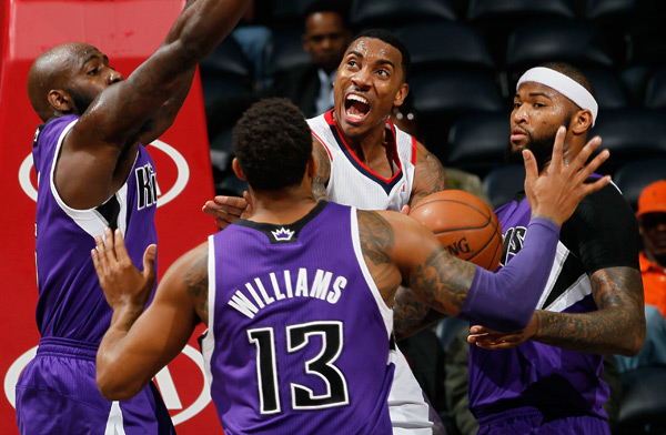 Jeff Teague, Quincy Acy, Derrick Williams and DeMarcus Cousins :: Getty Images