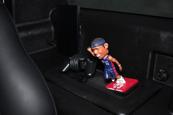 The Hummer H2 that LeBron James drove during high school includes a bobblehead. (Autos Direct Online)