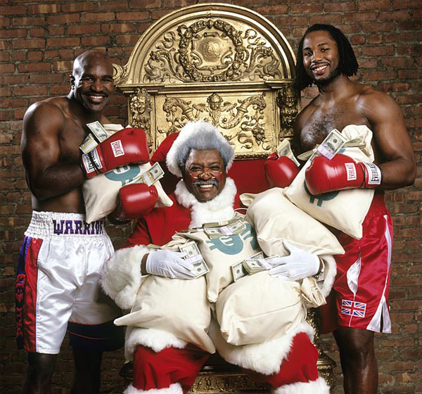 Evander Holyfield, Don King and Lennox Lewis :: Neil Leifer/SI