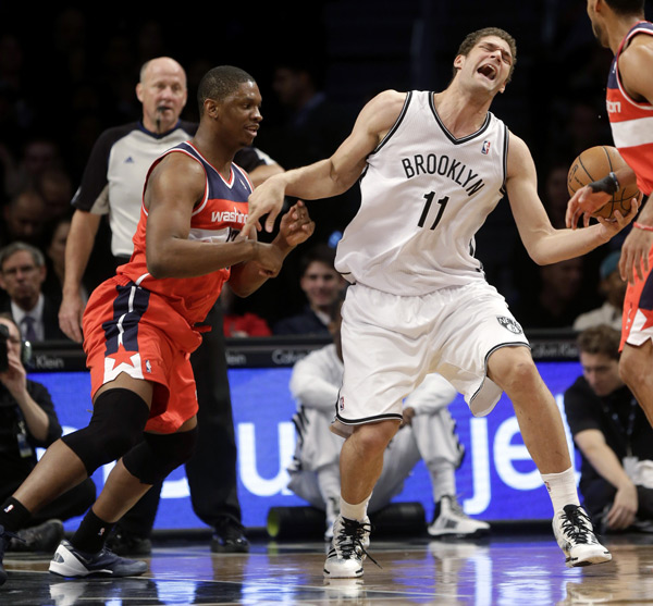 Kevin Seraphin and Brook Lopez :: AP