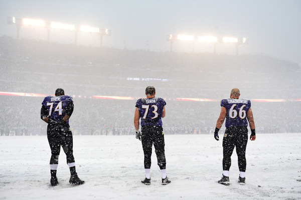 Michael Oher, Marshal Yanda and Gino Gradkowski :: Patrick Smith/Getty Images