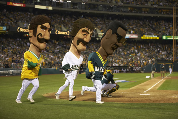 Rollie Fingers, Dennis Eckersley and Rickey Henderson mascots :: Brad Mangin/SI