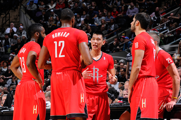 Jeremy Lin (center) and the Rockets in their Christmas Day jerseys.  (D. Clarke Evans/Getty Images)