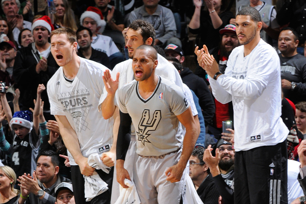 Spurs guard Patty Mills (center) in his Christmas Day jerseys.  (D. Clarke Evans/Getty Images)