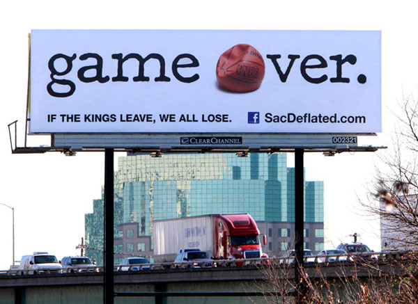 Fans of the Sacramento Kings erect a billboard to keep their team. (AP Photo/Rich Pedroncelli)