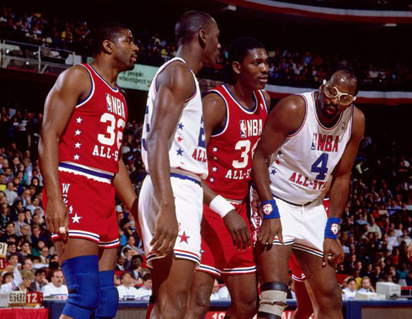 Magic Johnson, Michael Jordan, Hakeem Olajuwon and Moses Malone at the 1988 All-Star Game. (Getty Images)