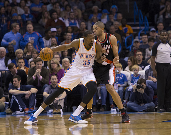 Kevin Durant and Nicolas Batum :: Layne Murdoch/NBAE via Getty Images